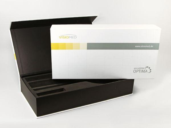 Klappschachtel mit Magnetverschluss für medizinische Produkte. Zweifarbig gestaltet - Außen Weiß und innen Schwarz. Mit individuellem Inlay aus festem Schaumstoff.