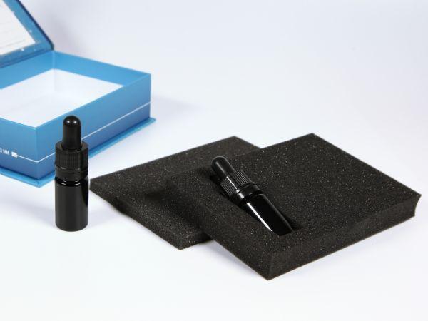 Individuell ausgestanztes Inlay aus Schaumstoff für Fläschchen