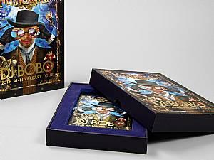 Stülpdeckelverpackung Dj Bobo mit Samtinlay und Goldprägung